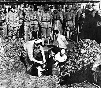 330px-Chinese_civilians_to_be_buried_alive[1].jpg